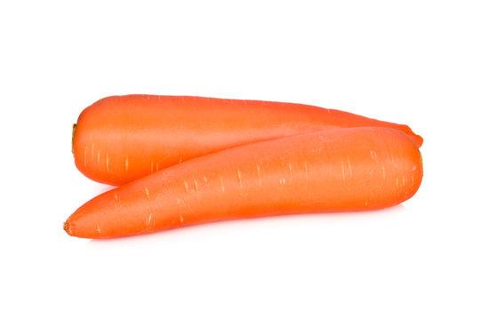 whole unpeeled fresh carrot on white background