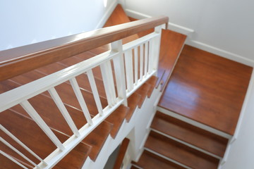 Keuken foto achterwand Trappen hardwood handrail banister and white steel balustrade on brown wooden stair interior decorated modern style of residential house