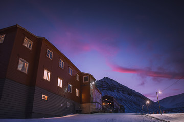 norway landscape nature of the winter mountains of Spitsbergen Longyearbyen city Svalbard arctic polar night sunset pink sunrise sky