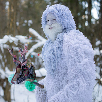 Yeti fairy tale character in winter forest.