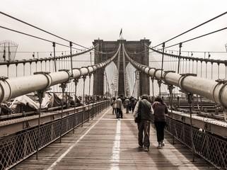 People Walking On Brooklyn Bridge Against Sky