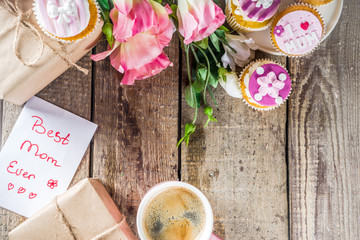 Happy moms day greeting background. Mothers day sweet cupcakes, with gift boxes, coffee cappuccino...