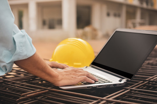Close-up construction worker using computer helmet  on building site