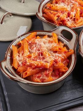 Oven baked penne rigatte with tomato sauce, mozarella and ham (pasta al forno), homemade