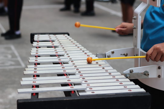 Cropped Image Of Person Playing Xylophone In City