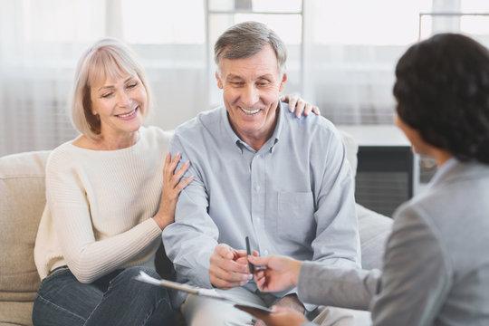 Senior couple visiting financial advisor at office