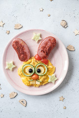 Easter breakfast scrambled eggs with cute bunny face