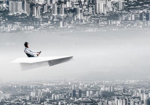 Happy aviator driving paper plane