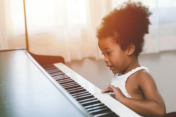 children girl playing piano looking exciting happy and enjoy with music instrument and be player