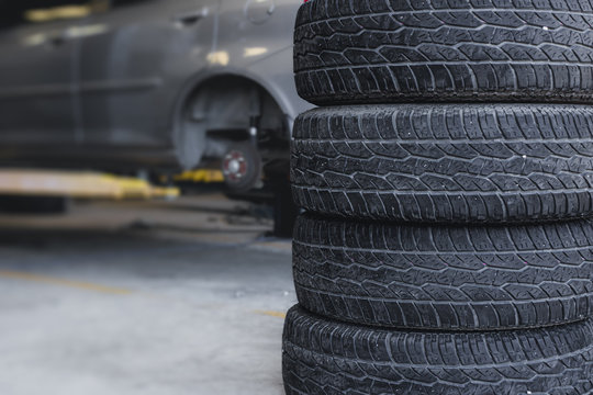 Car tire replace in garage, old tyre wheel service for background.