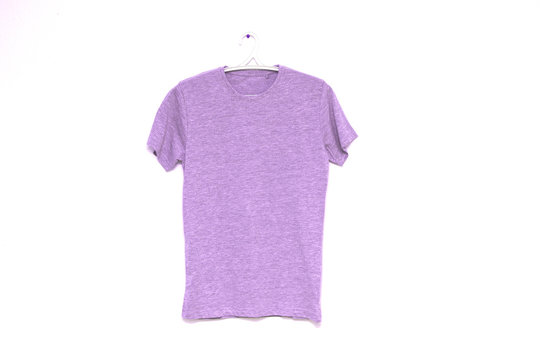 Blank lilac t-shirt hanging mock up on white wall, front view.