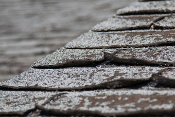 Obraz Old worn out asphalt shingles on the roof of a residential home. - fototapety do salonu