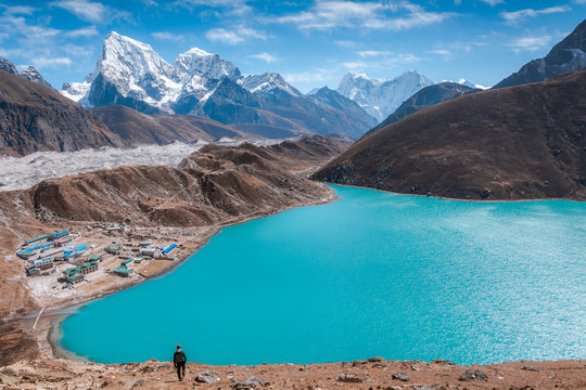 A trekker walking down to the camp in front of Gokyo Lake, Sagarmatha national park, Everest Base Camp 3 Passes Trek, Nepal