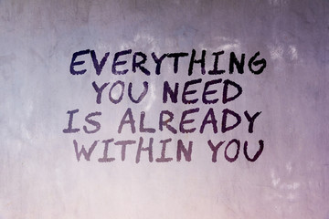 Motivation and inspirational quotes - Everything you need is already within you. Blurry background.