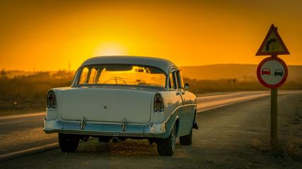 colorful baby-blue cuban classic car in sunset light, cuba