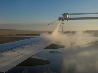 Deicing airplane wing before take off