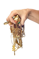 Hand Holding Tangled Mess of Jewelry