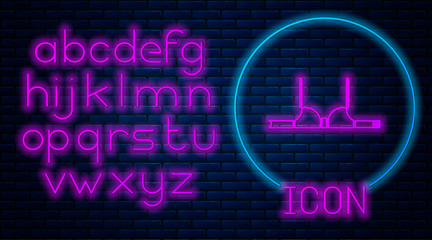 Glowing neon Bra icon isolated on brick wall background. Woman underwear. Neon light alphabet. Vector Illustration