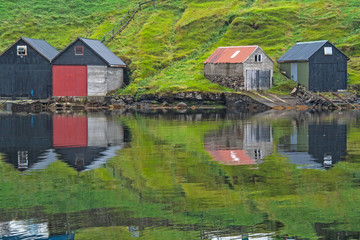 Tiny Homes Reflecting in the Water in a Fishing Village