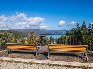 Benches by Lake Bracciano, a lake of volcanic origin in the Italian region of Lazio, near Rome, Italy.