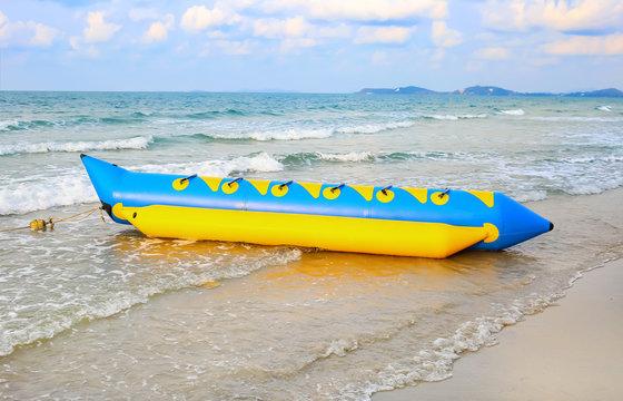 Colorful banana boat floating near the shore