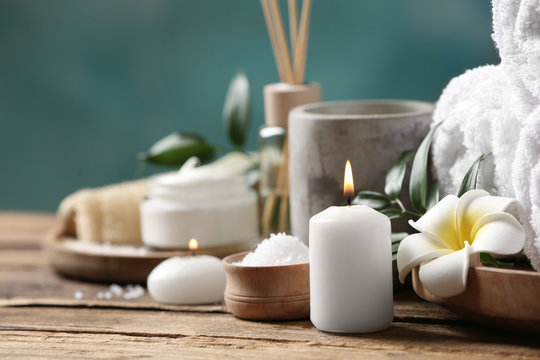 Beautiful spa composition with plumeria flower on wooden table, closeup