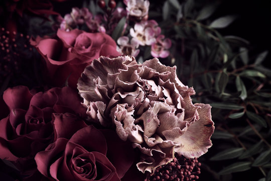 Beautiful bouquet of different flowers on black background, closeup. Floral card design with dark vintage effect