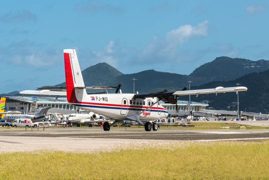 St. Maarten, Netherlands - December 17, 2018: The De Havilland Canada DHC-6-300 Twin Otter airplane preparing for takeoff at Princess Juliana International Airport in Sint Maarten - Saint Martin.