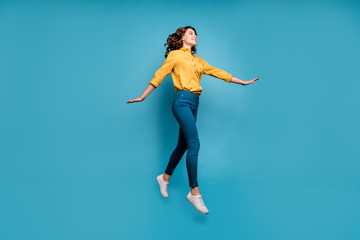Full length body size view of her she nice attractive lovely pretty cheerful cheery wavy-haired girl jumping strolling isolated on bright vivid shine vibrant green blue turquoise color background