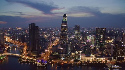 Fototapete - Aerial view of Ho Chi Minh City skyline in Vietnam at sunset