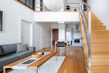 Two-floor open space apartment with wooden stairs and hardwood floor