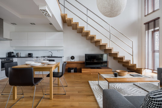 Two-floor apartment with wooden elements