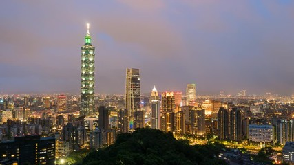 Wall Mural - Time-lapse Aerial view of Business district in city of Taipei, Taiwan at night