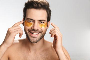 Photo of happy half-naked man looking at camera and smiling