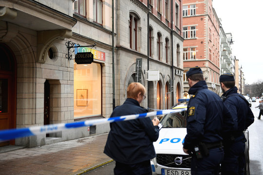 Police officers stand in front of an art gallery where Salvador Dali works have been stolen, in Stockholm