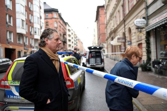 Art gallery owner Peder Enstrom stands behind police cordon after Salvador Dali works have been stolen, in Stockholm