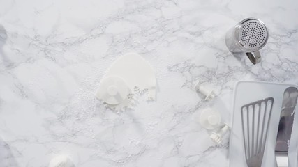 Wall Mural - Flat lay. Step by step. Rolling our white fondant on a marble counter.