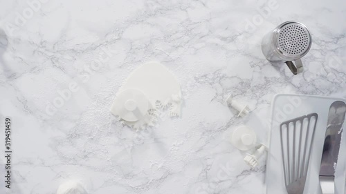Wall mural Flat lay. Step by step. Rolling our white fondant on a marble counter.