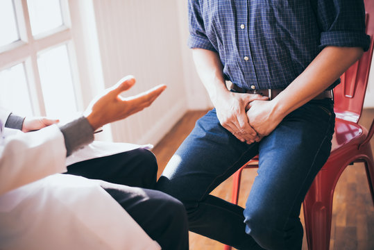 Male doctors and patients, sexual problems are discussing the symptoms and treatment methods.