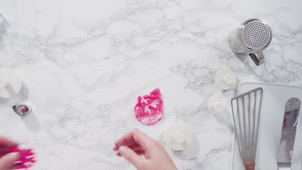 Wall Mural - Flat lay. Step by step. Rolling our pink fondant on a marble counter.