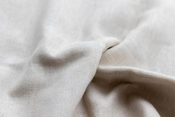 Natural linen fabric texture. Rough crumpled burlap background. Selective focus. Closeup view