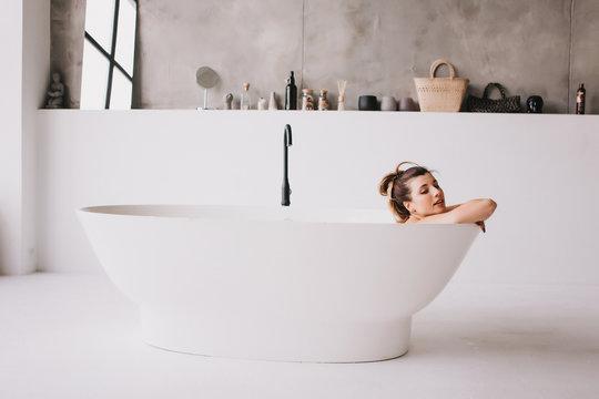 Beautiful woman relaxing in the bathtube.