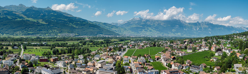 Beautiful panoramic summer view of the capital of Liechtenstein Vaduz and the Swiss Alps in the background.  Fotomurales