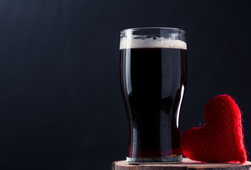 A glass of dark beer porter or stout, a surprise for a man on Valentine's day