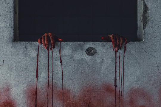 horror scence of woman with scary hand  at abandoned house. hand through the hole wall. Halloween concept