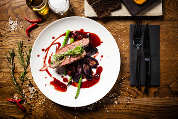 Duck breast served on a plate in restaurant Fotobehang