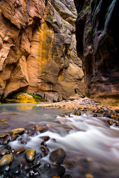 Beautiful light relfects off of the Virgin River and canyon walls deep in The Narrows of Zion National Park, Utah.