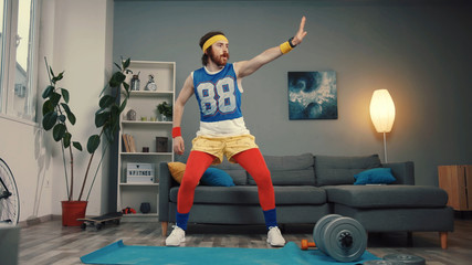 Obraz Attractive funny guy in retro sports costume dancing and warming up before hard training. - fototapety do salonu