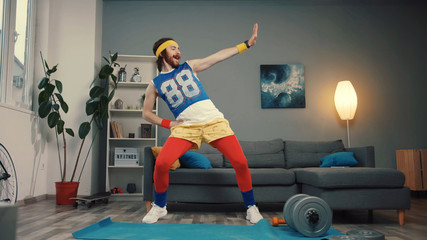Wall Murals Dance School Funny stupid-looking reto fitness man dancing enjoying music and warming up on workout in the living room.