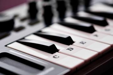 Close up image midi electronic musical keyboard, modern device, horizontal image selective focus, no people